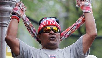 Участник акций протеста в Таиланде