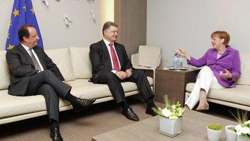 Франсуа Олланд, Петр Порошенко и Ангела Меркель. Архивное фото