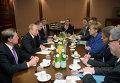 Президент России Владимир Путин и канцлер Германии Ангела Меркель во время рабочей встречи в Милане