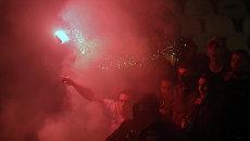 Фанаты Црвены Звезды во время гостевого матча чемпионата Сербии по футболу с Партизаном