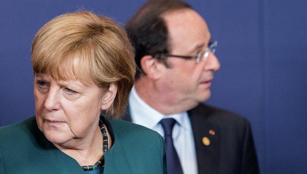 Президент Франции Франсуа Олланд и Федеральный канцлер Германии Ангела Меркель. Архивное фото.