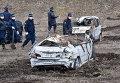 """Полицейские во время поисков останков пропавших без вести в районе АЭС """"Фукусима"""", Япония. 11 марта 2014"""