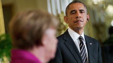 Президент США Барак Обама слушает выступление канцлера ФРГ Ангелы Меркель. Архивное фото