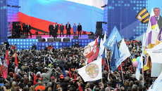 Президент России Владимир Путин выступает на митинге-концерте Мы вместе!. Архивное фото