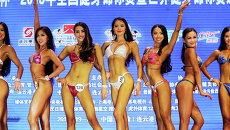 Участницы конкурса по бодибилдингу в Ляньюньгане, Китай