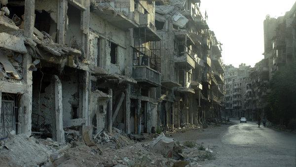 Разрушенные здания в результате боев в пригороде Дамаска, Сирия. Архивное фото