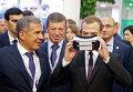 Председатель правительства России Дмитрий Медведев во время осмотра стендов инвестиционного форума Сочи-2015