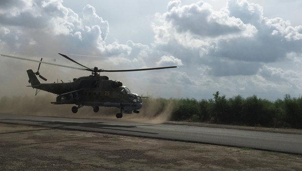 Российские ударные вертолеты МИ-24 вылетают на боевое задание с аэродрома Хмеймим, Сирия. Архивное фото