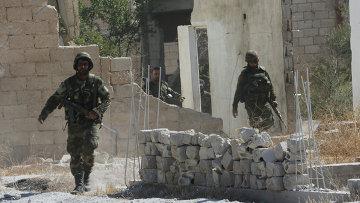 Сирийская армия входит в город Атшан (провинция Хама), освобожденный при помощи российской авиации. Архивное фото