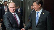 Президент России Владимир Путин и председатель Китайской Народной Республики (КНР) Си Цзиньпин во время встречи на полях саммита Группы двадцати (G20)
