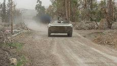 Сирийские солдаты и бронетехника вошли в занятый боевиками пригород Дамаска