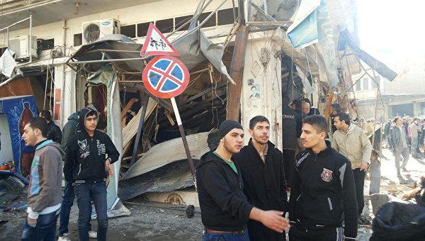 На месте взрывов в районе Аз-Захра города Хомс, Сирия