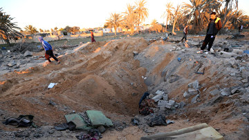 Последствия авиаударов США по позиция ИГ в Ливии. 19 февраля 2016. Архивное фото