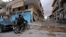 Солдаты сирийской армии (САА) на улицах Пальмиры. Архивное фото