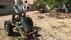 Брошенный террористами самодельный миномет в деревне Саф-Сафа. Архивное фото