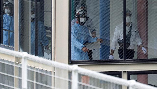 Спасатели в японском доме инвалидов, где мужчина устроил резню. 26 июля 2016 год