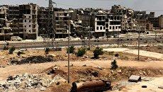 Разрушенные здания в районе Рамусе на юге города Алеппо в Сирии