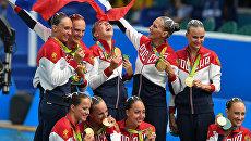 Спортсменки сборной России, завоевавшие золотые медали в произвольной программе групповых соревнований по синхронному плаванию на XXXI летних Олимпийских играх. Архивное фото