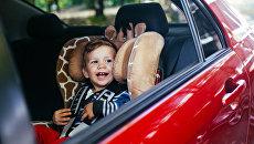 Ребенок в автомобиле. Архивное фото