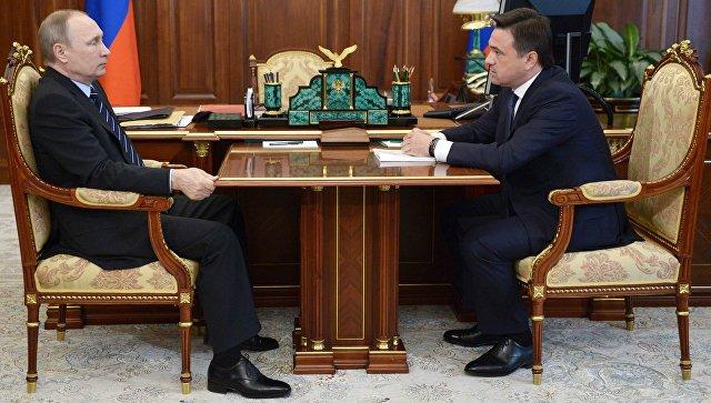 Президент России Владимир Путин и губернатор Московской области Андрей Воробьёв во время встречи в Кремле. 24 августа 2016