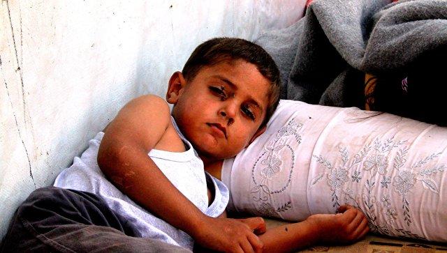 Дети из семей беженцев на линии фронта в районе 1070, юго-Запад Алеппо. Архивное фото