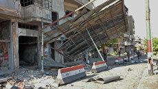 На месте взрыва в сирийском городе Хомс. 5 сентября 2016