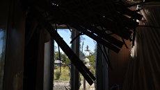 Разрушенный в результате ночного обстрела  дом в Макеевке. Архивное фото