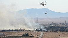Вертолеты Ка-52 Аллигатор в окрестностях освобожденного от боевиков города Эль-Карьятейн. Архивное фото