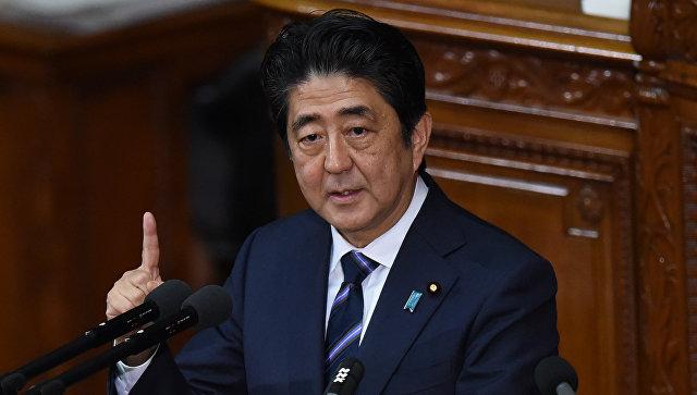 Премьер-министр Японии Синдзо Абэ во время выступления на открытии внеочередной сессии нижней палаты представителей японского парламента. 26 сентября 2016 года