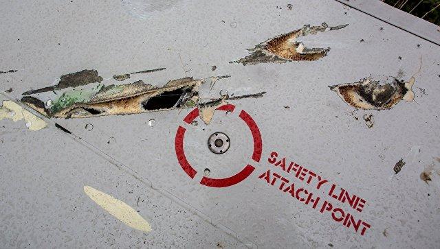 Обомки малайзийского лайнера Boeing 777 в Донецкой области. Архивное фото
