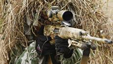 Снайпер на позиции во время учений ЮВО. Архивное фото