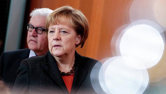 Франк-Вальтер Штайнмайер и Ангела Меркель. Архивное фото