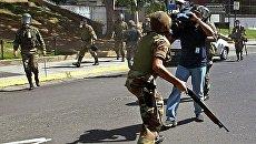 Разгон демонстрантов в Каракасе. Архивное фото