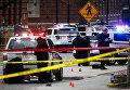 Криминалисты на месте наезда автомобиля на группу людей в Университете штата Огайо