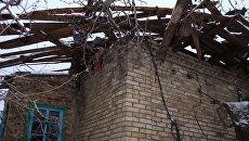 Дом, пострадавший от обстрелов, в Горловке. Архивное фото