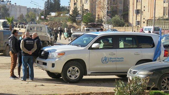 Первая колонна автобусов сбоевиками выезжает извосточного Алеппо