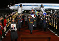 Встреча в Москве самолета с телом посла России в Турции Андрея Карлова