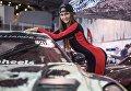 Модель на выставке Motorsport Expo в КВЦ Сокольники в Москве