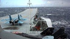 Истребитель МиГ-29К на палубе тяжелого авианесущего крейсера Адмирал Кузнецов в Средиземном море. Архивное фото