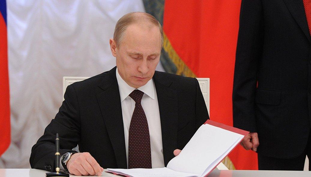 Путин подписал закон об удаленной идентификации клиентов банков