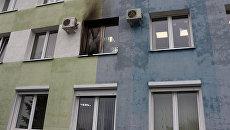 Последствия попадания коктейля Молотова в окно здания инспекции Министерства по налогам и сборам в Гомеле