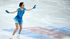 Евгения Медведева (Россия) выступает в короткой программе женского одиночного катания на чемпионате мира по фигурному катанию в Хельсинки
