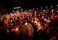Католики принимают участие в Шествии огней в рамках празднования Святой недели в Нахуазалко, Сальвадор