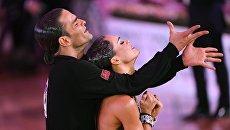 Аниелло Ланжелла и Андра Вайдилайте (Италия) выступают на чемпионате Европы по латиноамериканским танцам в Москве