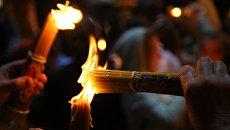 Схождение Благодатного огня в храме Гроба Господня в Иерусалиме. Архив