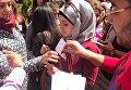 """Сирийские студенты во время акции """"Георгиевская ленточка"""" на территории Дамасского государственного университета"""