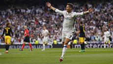 Криштиану Роналду празднует победу Реала над Атлетико в мадридском дерби в рамках первого полуфинального матча Лиги чемпионов в Мадриде. Испания, 2 мая 2017