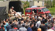 Раздача российской гуманитарной помощи в сирийской деревне. Архивное фото