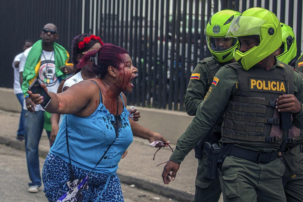 Пострадавшая женщина на забастовке в городе Кибдо, Колумбия