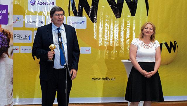 Руководитель Sputnik Азербайджан Азиз Алиев и редактор русской службы новостей канала СВС Эльнара Мамедова